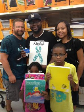 Charles helping families with school supplies - Rachel loved children and education!